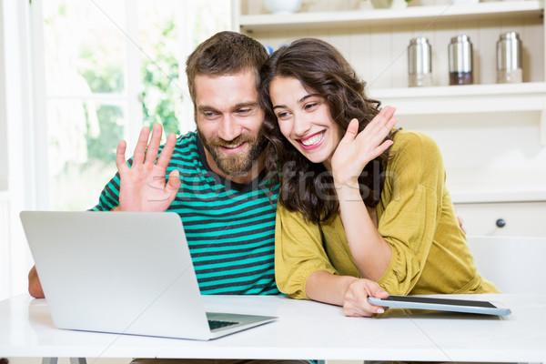 Couple having video chat on laptop  Stock photo © wavebreak_media