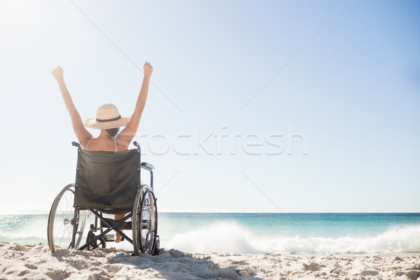 Wheelchair woman sitting  with arms up  Stock photo © wavebreak_media