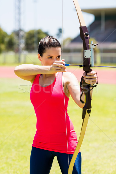 Kobiet sportowiec łucznictwo stadion kobieta Zdjęcia stock © wavebreak_media