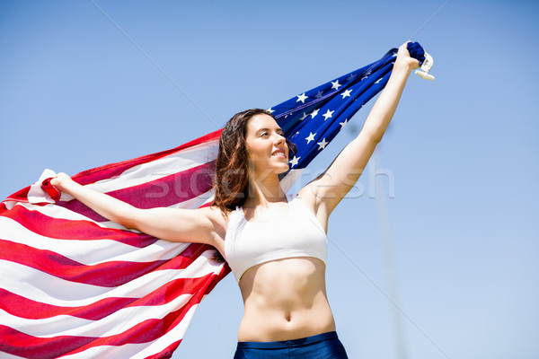 Női atléta tart amerikai zászló levegő győzelem Stock fotó © wavebreak_media