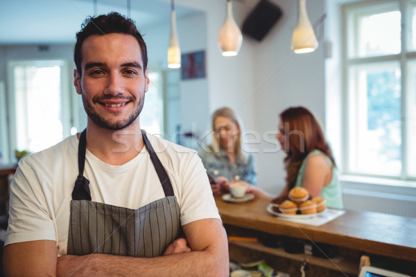Portrait of happy barista with arms crossed at coffee shop Stock photo © wavebreak_media