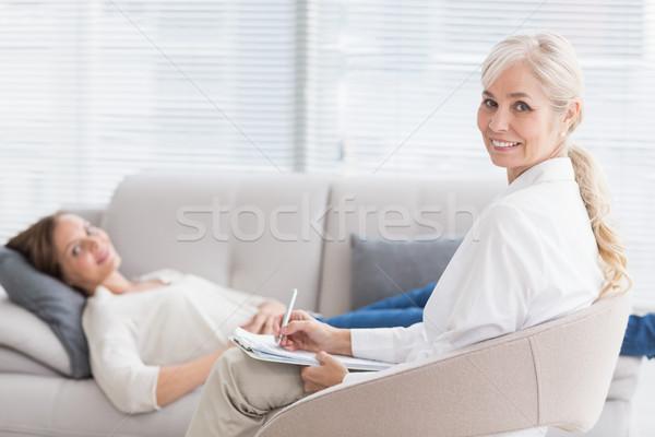 портрет улыбаясь терапевт пациент диван домой Сток-фото © wavebreak_media