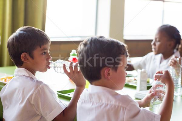 Schooljongen drinkwater fles kantine vrouw meisje Stockfoto © wavebreak_media