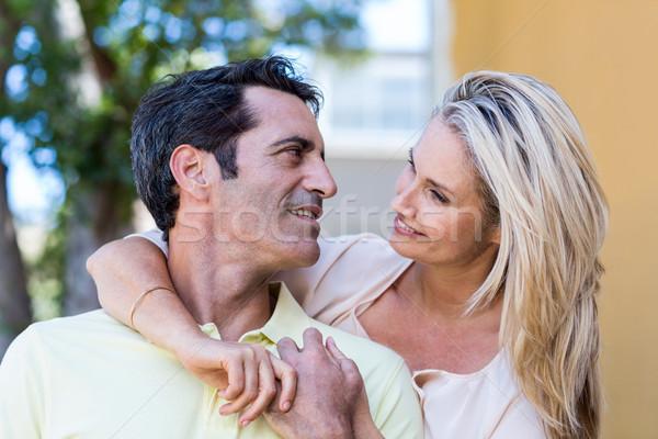 Romantic couple by building Stock photo © wavebreak_media