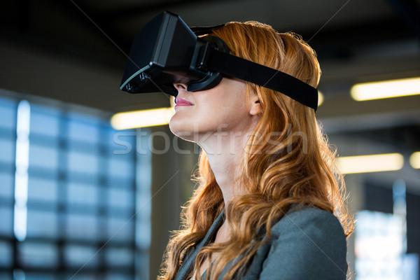 Young businesswoman using virtual reality simulator  Stock photo © wavebreak_media