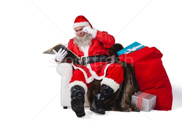 Mikulás olvas Biblia zsák karácsony ajándék Stock fotó © wavebreak_media