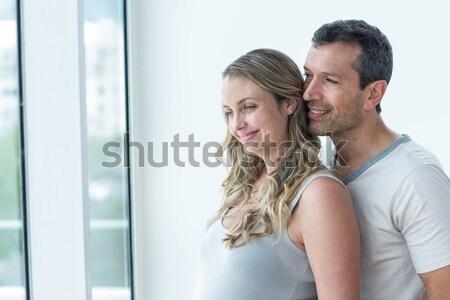 Couple holding keys in their new house Stock photo © wavebreak_media