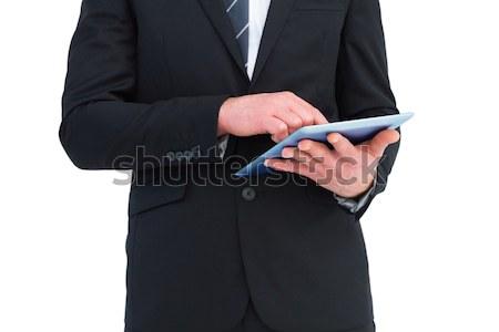 Businessman using digital tablet Stock photo © wavebreak_media