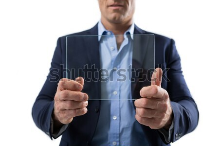 Businessman pretending to be using futuristic digital tablet Stock photo © wavebreak_media