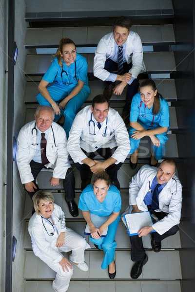 High angle view of doctors and surgeons sitting on staircase Stock photo © wavebreak_media