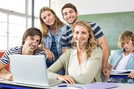 Studenti utilizzando il computer portatile classe bianco computer Foto d'archivio © wavebreak_media