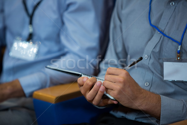 Business executive participating in a business meeting taking notes Stock photo © wavebreak_media