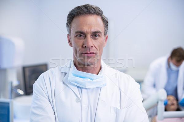 Confident dentist standing at dental clinic Stock photo © wavebreak_media