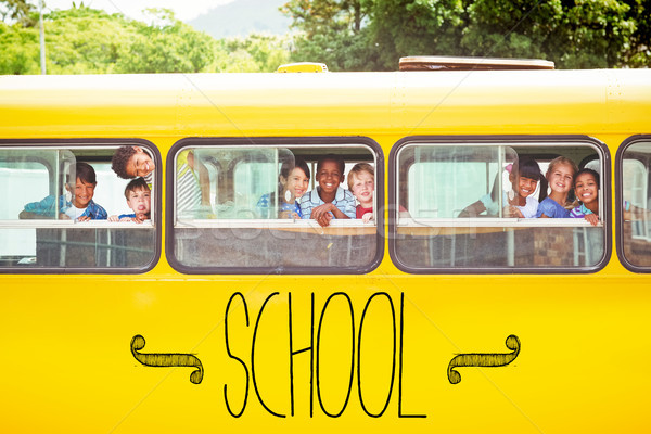 School against cute pupils smiling at camera in the school bus Stock photo © wavebreak_media
