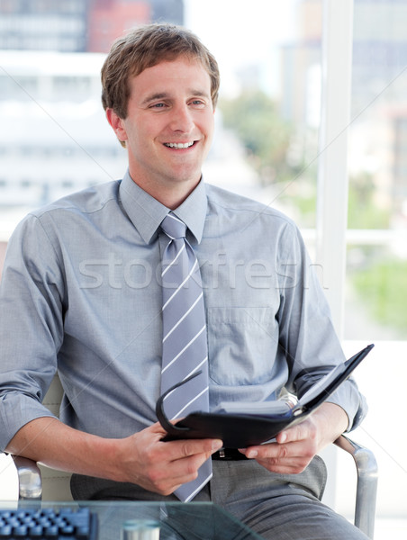 Charming male executive looking at his agenda Stock photo © wavebreak_media