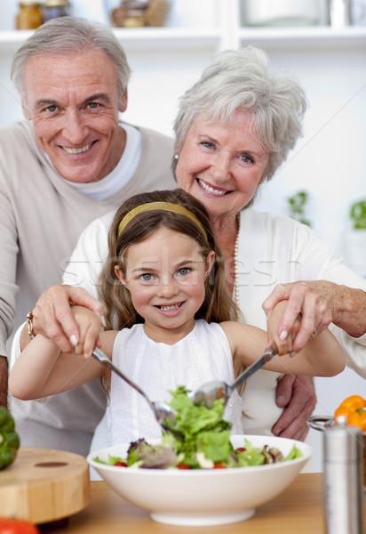Gülen dedesi yeme salata torun mutfak Stok fotoğraf © wavebreak_media