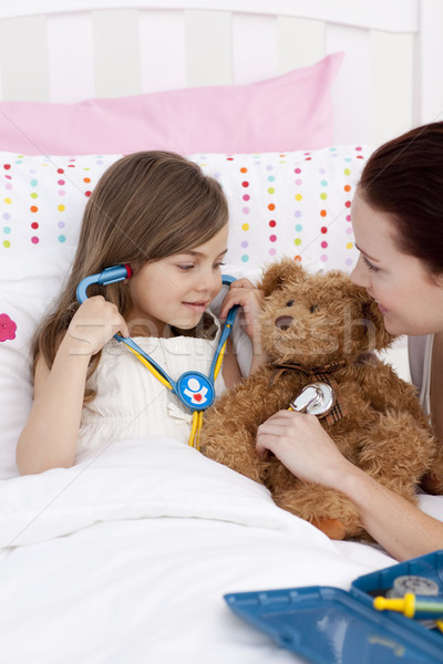 Mother and daughter playing doctors in bed Stock photo © wavebreak_media
