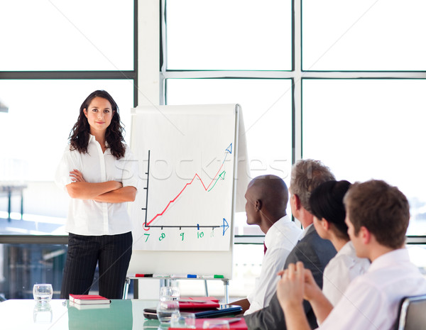 Stock photo: Confident businesswoman in a presentation with folded arms