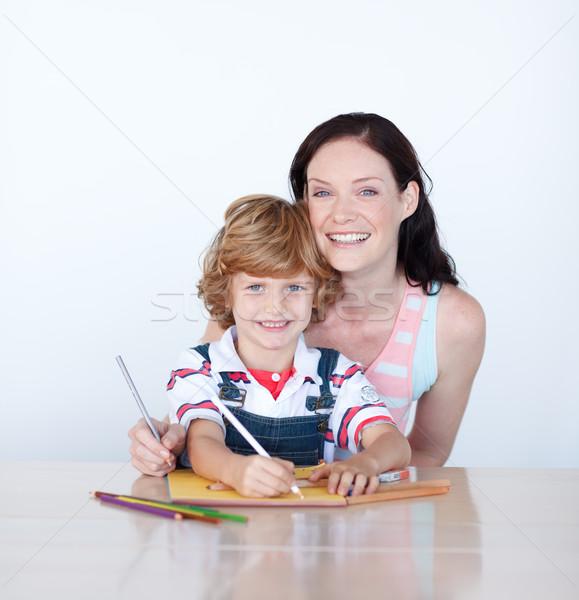 Anya fiú ír otthon mosolyog kamerába Stock fotó © wavebreak_media