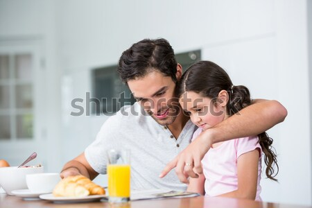 Young woman having breakfast on the bed with her boyfriend at home Stock photo © wavebreak_media