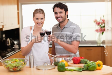Portrait of a happy couple drinking red wine at lunch Stock photo © wavebreak_media