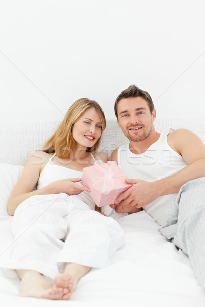 Stock photo: Smiling couple looking at the camera