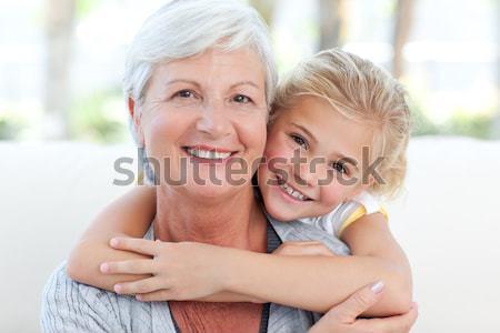 Dziewczynka babcia patrząc kamery rodziny tle Zdjęcia stock © wavebreak_media