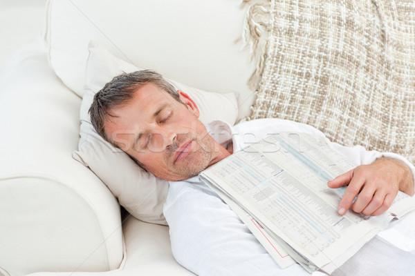 Bitkin adam uyku kanepe ev haber Stok fotoğraf © wavebreak_media