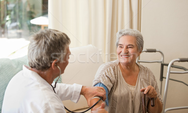 Arts bloeddruk patiënt medische home Stockfoto © wavebreak_media