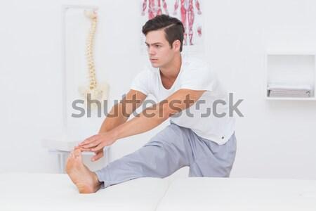 Férfi gyakorol jóga ágy szexi űr Stock fotó © wavebreak_media