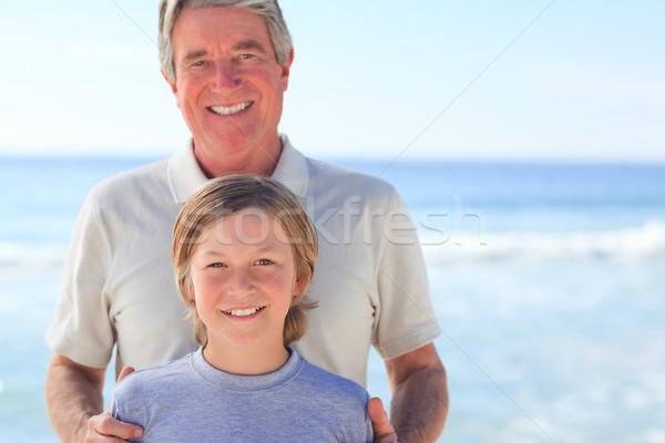 Foto stock: Abuelo · nieto · playa · cielo · agua · sonrisa