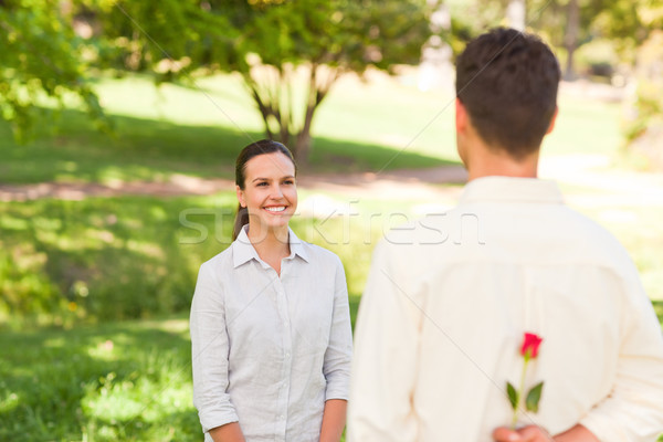 Man offering a rose to his girlfriend Stock photo © wavebreak_media