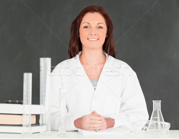 Mosolyog néz kamera osztályterem nő könyv Stock fotó © wavebreak_media