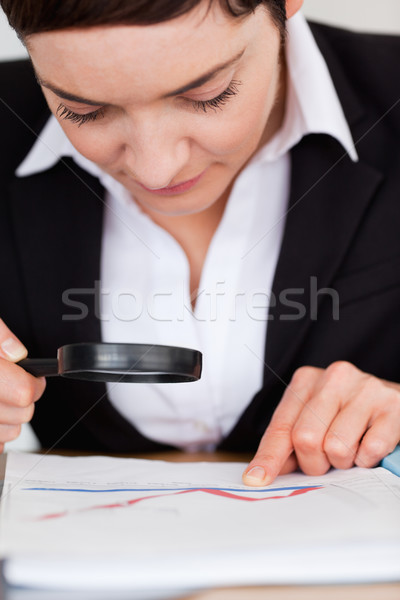 Short-haired woman looking through a magnifying glass Stock photo © wavebreak_media