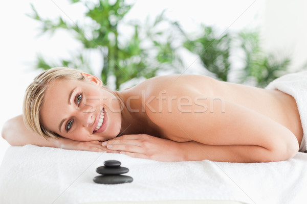 Good looking blonde woman lying on a lounger in a wellness center Stock photo © wavebreak_media
