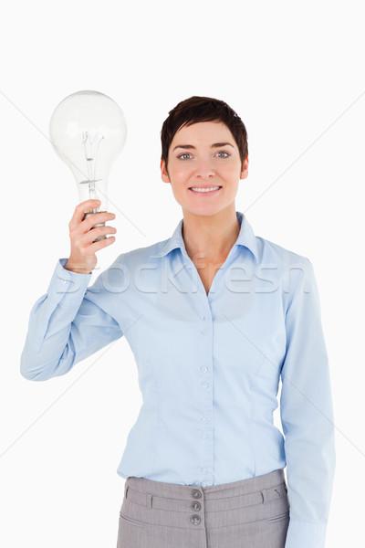 Nő tart villanykörte fehér üzlet kéz Stock fotó © wavebreak_media