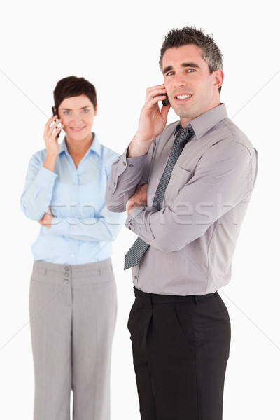Portrait of coworkers making a phone call against a white background Stock photo © wavebreak_media