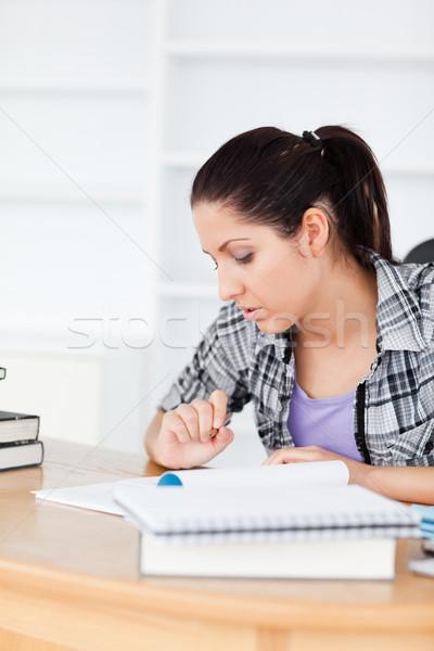Fiatal diák tanul könyvek könyv iskola Stock fotó © wavebreak_media