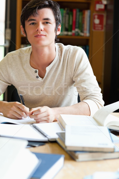 Serious student working in a library Stock photo © wavebreak_media