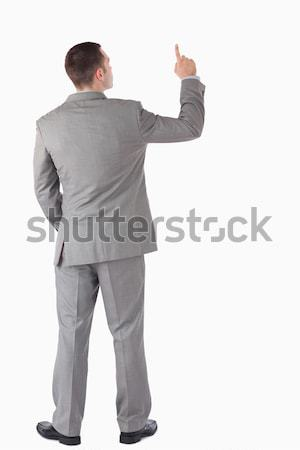 Portrait of a young businessman pointing at something against a white background Stock photo © wavebreak_media
