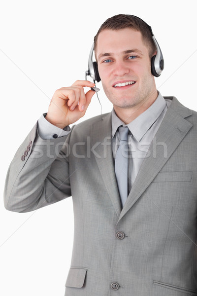 Portrait of a smiling operator using a headset against a white background Stock photo © wavebreak_media