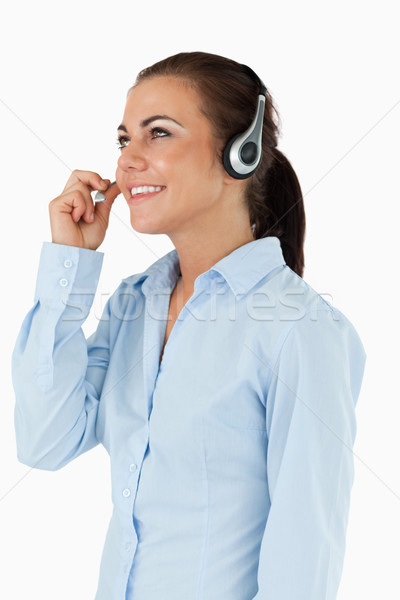 Side view of female call center agent against a white background Stock photo © wavebreak_media