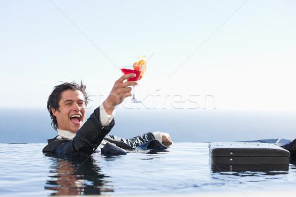 Zachwycony biznesmen relaks basen koktajl garnitur Zdjęcia stock © wavebreak_media