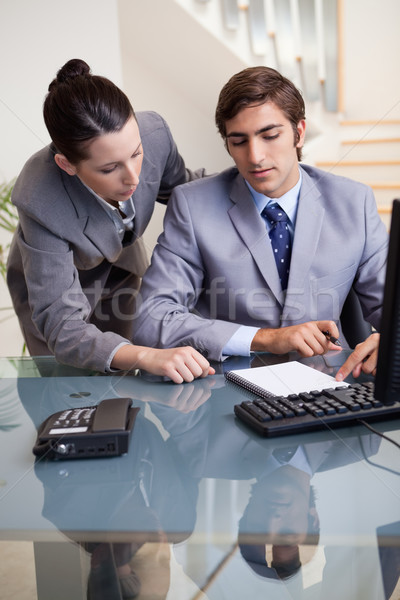 Young businesswoman mentoring her new colleague Stock photo © wavebreak_media