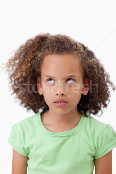 Portrait of a playful girl looking up against a white background Stock photo © wavebreak_media