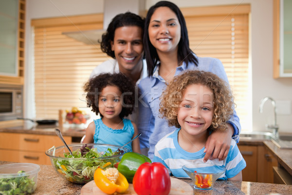 Young family preparing salad together Stock photo © wavebreak_media