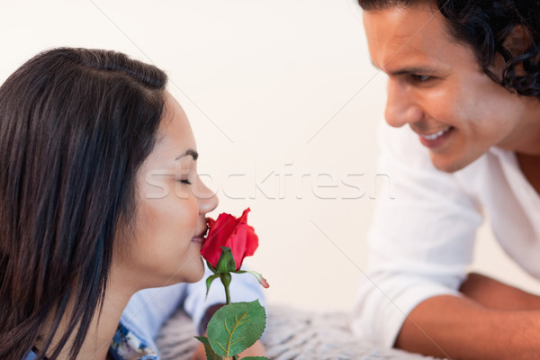 Young man giving his girlfriend a rose for valentines day Stock photo © wavebreak_media