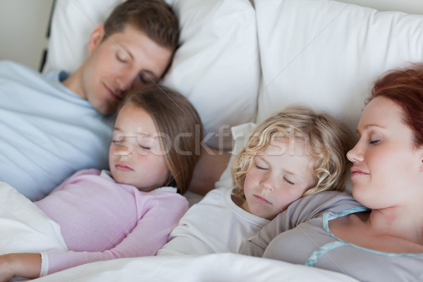 Young family snoozing together Stock photo © wavebreak_media