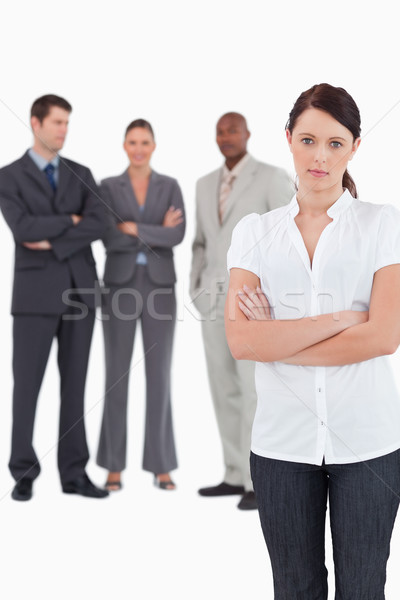 Tradeswoman with arms folded and three colleagues behind her against a white background Stock photo © wavebreak_media