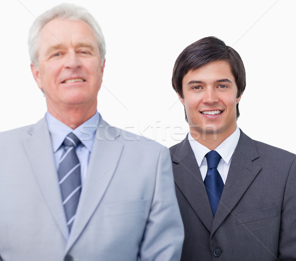 Young businessman with his mentor against a white background Stock photo © wavebreak_media